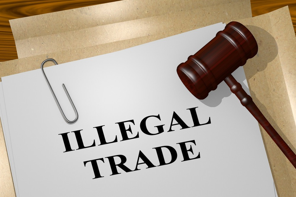 What is illegal trading and how do I avoid it?